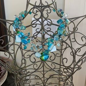 Lovely stringed beaded necklace in blues. Expands